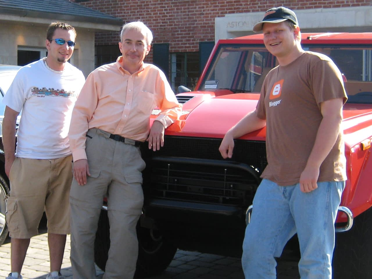 Mike, Dr. Warner, and Patrick in front of Lamborghini LM002