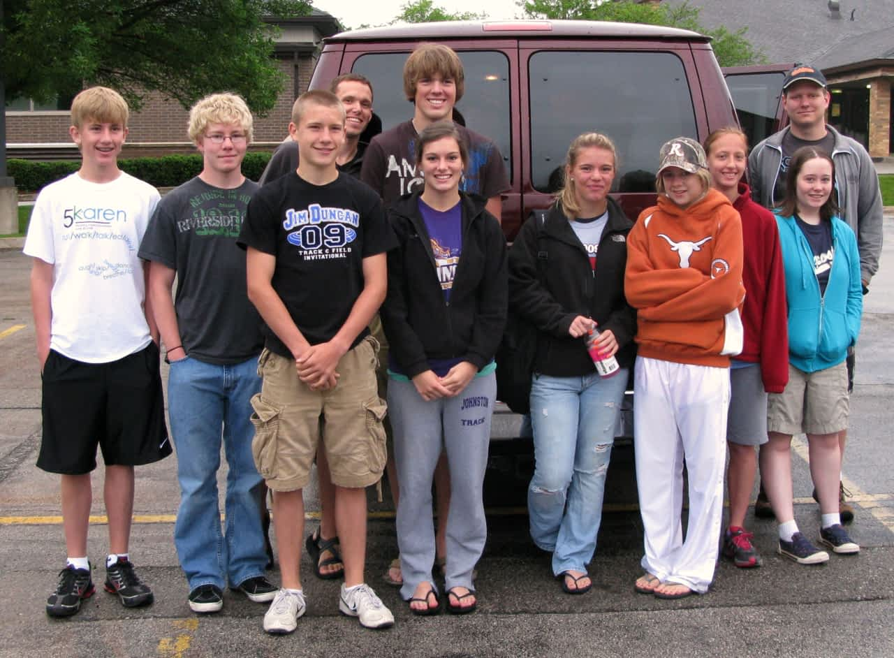 Youth in front of the van in Zion parking lot